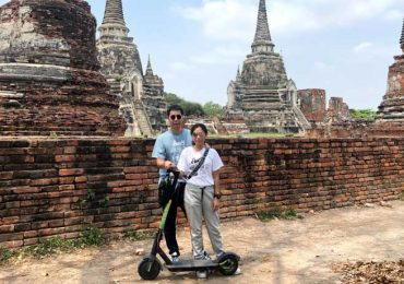 Couple on an E-Scooter Tour of Ayutthaya