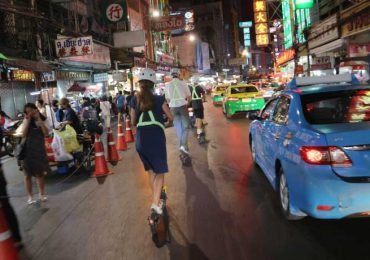 Go Scoot down Chinatown road at night