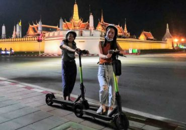 Two Thai girls outside the Grand Palace at Night