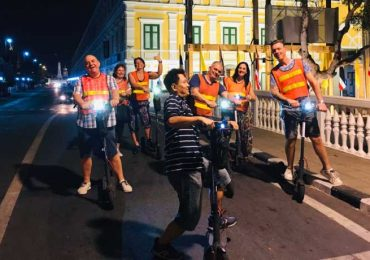 Having fun on a night scooter tour