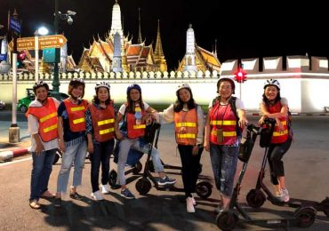 Group on a Scooter Tour at night