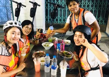 Eating street food on a Electric Scooter Tour