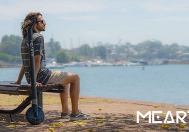 Mearth Scooter with Man on Bench